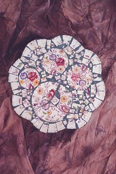 Stepping stone made with vintage Vernon Ware. Made by Donna Avery   Photo by Ron Avery