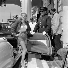 Diana Dors exits her Cadillac at the 1956 Cannes Film Festival