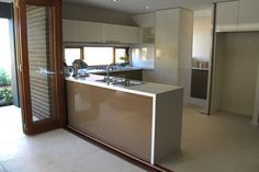 Angela Steyn Interiors: Kitchen & Bathroom Design - like the butler's pantry just peeking through doorway. Similar in that it has a window for splashback