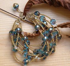 Inspiration piece but i'd gladly pay the $35 for this multi strand bracelet. Materials used to make it are listed on the sale page. BEAUTIFUL!