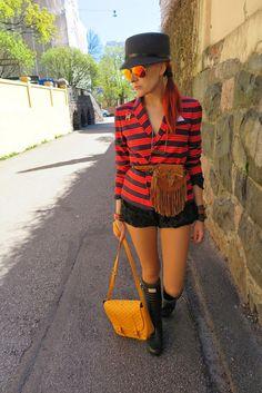 Hat: Whistles Blazer: Gap Beltbag: Ralph Lauren  Bloomers: Miu Miu Bag: Goyard Rainboots: Hunters & Jimmy Choo Sunglasses: Rayban Necklace: Tebian Bracelets: Hermes and Louis Vuitton Brooch: Chanel Tights: Wolford