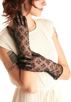 DARK SHADOWS GLOVES  Every girl needs a bit of mystery in her life, and in her closet. Featuring an elegant, tiny floral pattern and a sophisticated longer cut, these dramatic black lace gloves are just the thing to add some dazzle to your wardrobe! Pair with your favorite gown for a glamorous look or match with a long cardigan and jeans for a daring take on an old standard!    www.modcloth.com