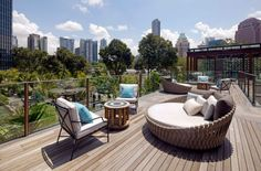 Tosca daybed by luxury outdoor furniture brand Tribù at Twin Peaks in Singapore