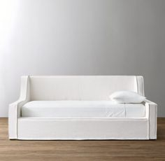 RH Baby & Child's Wynne Slipcovered Daybed:We took the welcoming silhouette of a classic lounge chair and transformed it into an oversized oasis of comfort. The sloped arms lend a modern, streamlined look while the flange-edged slipcover imparts casual appeal that suits a young person's space.