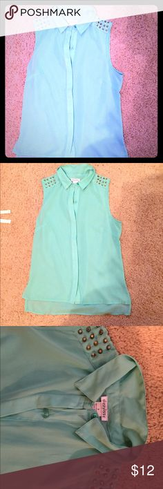Tank top Beautiful turquoise blouse with gold studs on each shoulder. Great summer top I love, just doesn't fit anymore. Will accept offers! Forever 21 Tops Tank Tops
