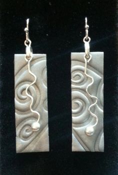 Polymer Clay Earrings by SoulfulEscape  One image or pattern divided into two instead of a pattern repeated twice.