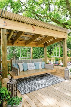 Love this Porch Swing Bed with the metal roof above it, flower boxes along the side, and hanging wooden window panes!