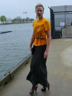 bright top belted over striped maxi skirt