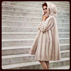 Model in a hooded mink coat by #Dior, photo by Georges Saad, 1961. Please note her fab cocktail ring. #tbt #jewelry