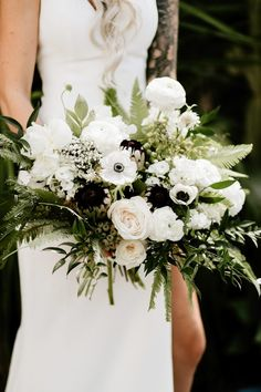 This ethereal bouquet was full of white florals + greenery | Image by Lauren Scotti