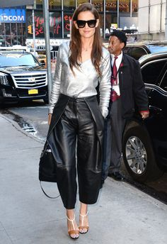 Katie Holmes in a long-sleeve metallic sweater and her pleated leather Zac Zac Posen culottes.