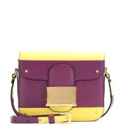 Valentino - Rivet leather shoulder bag - Move over two-tone, Valentino makes it all about the tri-tone colour variation. A pop of ivory against horizontal stripes of purple and yellow reflects the Italian pop art mood that inspired this collection. It's practical too, with three separate compartments ready to hold your essentials. Give menswear hues a luxe update and carry this over your shoulder. seen @ www.mytheresa.com
