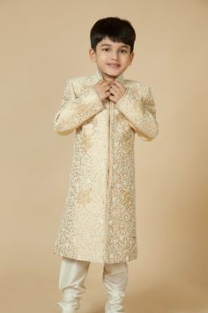 Polyster brocade sherwani embellished with machine embroidery, zardozi and sequins work. Item number KB15-02