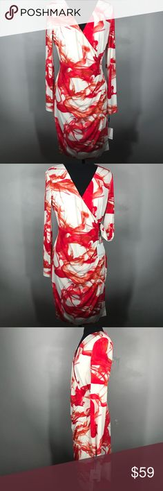 """NWT Calvin Klein Faux wrapped dress Sz 10 Brand new with the tag  Size 10 Faux wrapped long sleeves dress Draped on the side Color is red and white  Perfect for Christmas  Stretch dress  Formal or informal dress  Measurements chest 19 1/2"""" Length 37"""" Calvin Klein Dresses Midi"""
