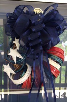Happy 4th of July using mason jar lids, a little spray paint, craft stars, ribbon , glue gun and grape vine. Very easy. There are a lot of ways the rings can be arranged.