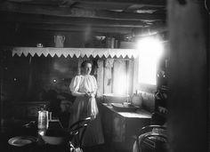 Woman inside a settler's hut