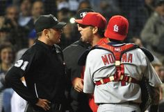 St. Louis Cardinals Team Photos - ESPN CHICAGO, IL - JULY 08: (L-R) Home plate umpire Pat Hoberg #31 Mike Matheny #26 of the St. Louis Cardinals and Yadier Molina #4 argue during the sixth inning on July 8, 2015 at Wrigley Field in Chicago, Illinois. (Photo by David Banks/Getty Images)