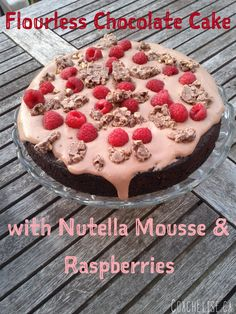 Flourless chocolate cake with Nutella mousse and raspberries! Free 7-day clean eating challenge at ElisesChallenge.com