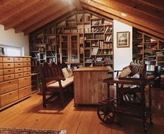 Imagine having a really rough day at work, heading straight up to your attic, and picking out a good book. | 22 Home Libraries That Will Give You Serious Reading Goals
