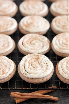 These Cinnamon Roll Sugar Cookies have cinnamon in the batter of the soft, chewy cookies, with additional cinnamon sprinkled on top of the fluffiest cream cheese frosting! From DessertNowDinnerLater.com