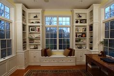 Custom designed, painted library room. Cabinetry and paneling harmoniously blended around each of the four 11-foot walls.