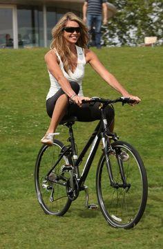 Elle McPherson rides bikes