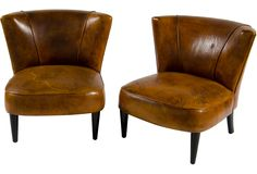 vintage leather slipper chairs ... these would be perfect for next to the piano, so M can play guitar