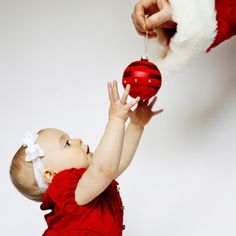 Christmas photo idea with dads hand as Santa! Cut the top off a cheap Santa hat and stick hand through.