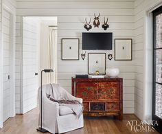 In the newly added keeping room next to the master suite, the shiplap door blends into the wall when closed.