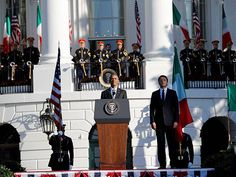 President Barack Obama and Italian Prime Minister Matteo Renzi stand on stage during a state arrival ceremony