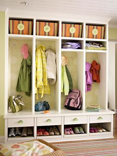 Add flair to an entry using wallpaper. Here, open locker cubbies transform the entry and make it easy for the whole family to access and organize gear. Pretty wallpaper lines the backs of the lockers for style and dimension./