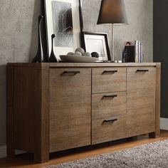 Our Myra II collection is a versatile set of furniture. Its modern rustic design with walnut finish also gives a clean, bold country look. Three deep middle drawers in the middle provide storage for small odds and ends, flatware or tableware