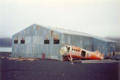 Abandoned hangar and fuselage