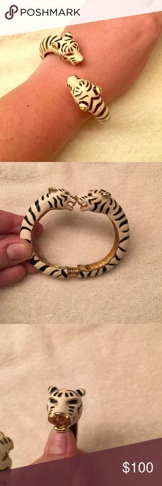 Kenneth Jay Lane black white tiger bracelet bangle Kenneth Jay Lane KJL black and white tiger bangle bracelet.  Bracelet is gold with white and black enamel stripes.  Two tiger heads roaring at opening.  See last photo - one of the black enamel tiger stripes is missing so you just see plain gold. Kenneth Jay Lane Jewelry Bracelets