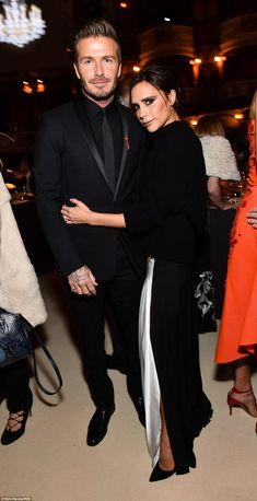 She's a winner: David and Victoria Beckham looked loved up as they partied with the fashion set in London on Monday night