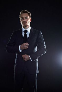 Michael Fassbender. Suit adjustment. Look of hot distain.