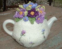 white tea cozy with purple violet flowers
