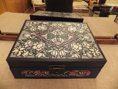 Hanji box made out of cardboard and handmade mulberry paper. Hand cut designs are placed on top.