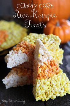 Candy Corn Rice Krispie Treats!  SO EASY and the perfect treat to bring to any Halloween themed party! #halloween #candycorn #dessert