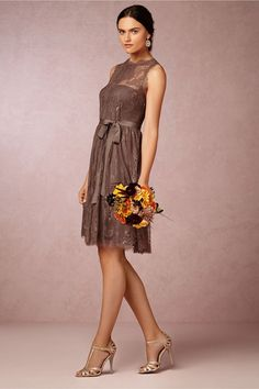 Embrace earth tones with these brown lace bridesmaid dresses. See more stunning styles here: http://www.mywedding.com/articles/brown-bridesmaid-dresses/