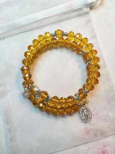 Stunning Amber Gold Crystal Rosary Bracelet, Catholic Hand Strung Memory Wire Rosary Bracelet by LivAriaDesigns on Etsy