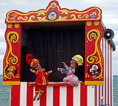 Punch & Judy is a traditional English puppet show based on the earlier Italian commedia dell'arte. It features Mr Punch, who is violent and abusive, interacting with his wife Judy Rachel Thompson, Types Of Puppets, Origami, Punch And Judy, Toy Theatre, British Seaside, Marionette, Puppet Show, Finger Puppets
