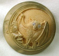 ButtonArtMuseum.com -  Hand Carved Vegetable Ivory Button Bat on Crescent Moon Face w Paste Eyes