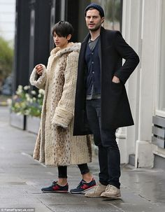 Low key: The married couple, who are parents to 16-month-old daughter Dulcie, appeared to be in great and relaxed spirits as they casually made their way along the streets in London