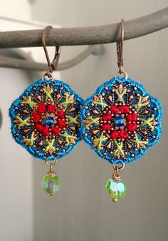 embroidered earrings made by barbara schär