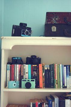 Cameras and books.