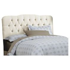 """Headboard with button-tufted detail. Handmade in the USA.Product: Headboard    Construction Material: Pine wood, polyester and cotton    Color: Parchment   Features:    Luxurious shantung silk-like upholstery    Diamond tufted detail    Handcrafted      Dimensions:   Twin: 51"""" H x 41"""" W x 4"""" D  Full: 51"""" H x 56"""" W x 4"""" D   Queen: 51"""" H x 62"""" W x 4"""" D   King: 51"""" H x 74"""" W x 4"""" DCalifornia King: 51"""" H x 78"""" W x 4"""" D Note: Pillows and linens not included"""