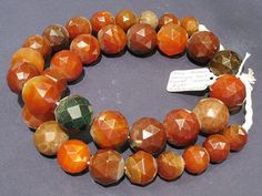 This is an incredible strand of large, round, hand-faceted carnelian beads. The beads measure 25.5mm in diameter.