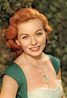 1940s sweetheart Jeanne Crain vamped up her on-screen persona and her hair in the 1950s. I wholeheartedly approve.