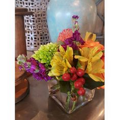 Needing a last minute gift? We have arrangements ready to go! Luscious hypericum and bold hydrangea bud are sure to put a smile on your loved one's face. #collegeflowers #lubbock